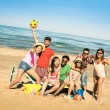 Group of multiracial happy friends having fun with beach sport games - International concept of summer joy and multi ethnic friendship all together  - Sunny afternoon color tones with tilted horizon — Stock fotografie #73793023