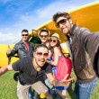 Best friends taking selfie at aeroclub with ultra light airplane - Happy friendship fun concept with young people and new technology trend - Sunny afternoon vivid color tones - Fisheye lens distortion — Stock Photo #75655135