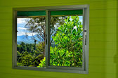 Summer field and mountains seen through the window — Stock Photo
