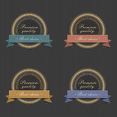 Golden labels with ribbons — Stock Vector