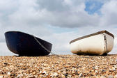 Two upturned row boats moored on the foreshore — Stock Photo