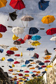 Colourful umbrellas broken by wind — Stock Photo