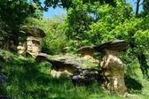 Erratic boulders on earth pillars — Stock Photo