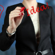 Businesswoman  drawing word idea  by  a red pen  — Stock Photo #65311993
