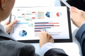 Business colleagues working and analyzing financial figures — Stock Photo