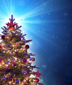 Christmas tree with shining blue star — Stok fotoğraf