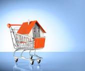 House in shopping-cart - for real estate background — Stock Photo