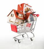 Many houses in shopping-cart — Stock Photo