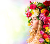 Spring portrait - hat of flowers — Stock Photo