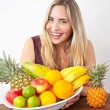 Young healthy beautiful woman with a bowl of fresh exotic fruit — Stock Photo #51862871