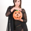Woman in witch costume with halloween pumpkin — Stock Photo #55930425