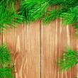 Fir branches on wooden table. Copyspace background. — Stock Photo #62452779