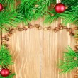 Fir branches with pine nuts and christmas toys. Copyspace background. — Stock Photo #62452799