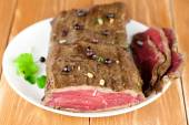 Delicious dinner of rare roast beef — Stock Photo