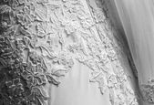 Embroidered flowers of bride dress — Stock Photo