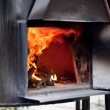 Black iron oven on fire — Stock Photo #54867357