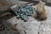 Load of new alloy nuts — Stock Photo