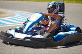 People having fun on a go cart. Summer season — Stock Photo