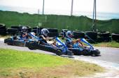 Boys having fun on a go cart. Out of track jump — Stock Photo