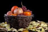 Basket full of autumn fruits — Stock Photo