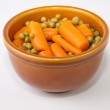 Bowl of boiled carrots and green peas — Stock Photo #61943047