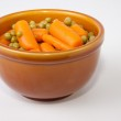 Bowl of boiled carrots and green peas — Stock Photo #61943341