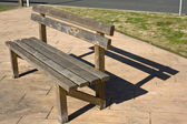 Rustic wooden bench — Stock Photo