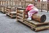 Wooden train on playground — Stockfoto