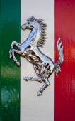 Cavallino Rampante, symbol of Ferrari, over the Italy flag — Stock Photo