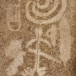 Ancient petroglyph with hunters figures — Stock Photo #70450807