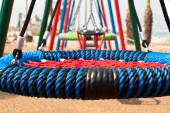 Swings in a recreation area — Stock Photo