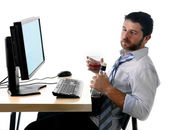 Alcoholic business man drinking whiskey sitting drunk at office with computer — Stock Photo