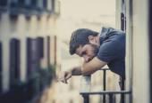 young man at balcony in depression suffering emotional crisis — Stock Photo