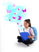 Happy sweet little Hispanic school girl smiling reading magic butterflies book  — Stock Photo