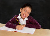 Happy Latin little girl with notepad smiling in back to school concept — Stock Photo