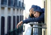 woman suffering depression and stress outdoors at the balcony — Photo