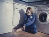 Lonely and sick woman sitting on kitchen floor in stress depression and sadness — Stock Photo