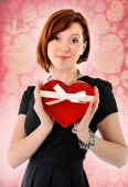 Beautiful red hair woman holding heart shape box anniversary box — Stock Photo