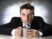 Addict businessman holding cup of coffee anxious and crazy in caffeine addiction — Stock Photo