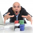 Internet gambling addict businessman on computer loosing lots of money betting on poker game — Stock Photo #56098597