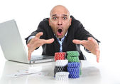 Internet gambling addict businessman on computer loosing lots of money betting on poker game — Stockfoto