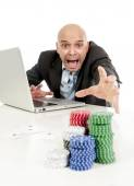 Internet gambling addict businessman on computer loosing lots of money betting on poker game — ストック写真