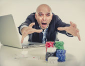 Internet gambling addict businessman on computer loosing lots of money betting on poker game — Stock Photo