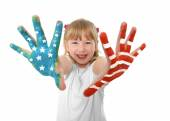 Happy sweet and cute small blonde hair girl showing hands painted with United States flag — Stock Photo