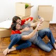 Happy couple moving together in a new house taking selfie video and pic — Stock Photo #56719701