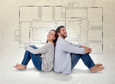 Young couple dreaming and imaging their new house in real state concept — Stock Photo