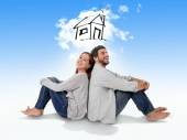 Young couple dreaming and imaging their new house in real state  — Stock Photo