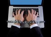 Hands of businessman addicted to work bond with chain to computer laptop in workaholic — Stock Photo