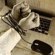 Hands of businessman addicted to work bond with mouse cable to computer laptop in workaholic — Stock Photo #58230533