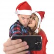 Young romantic couple in love taking selfie mobile phone photo at Christmas — Stock Photo #58583387